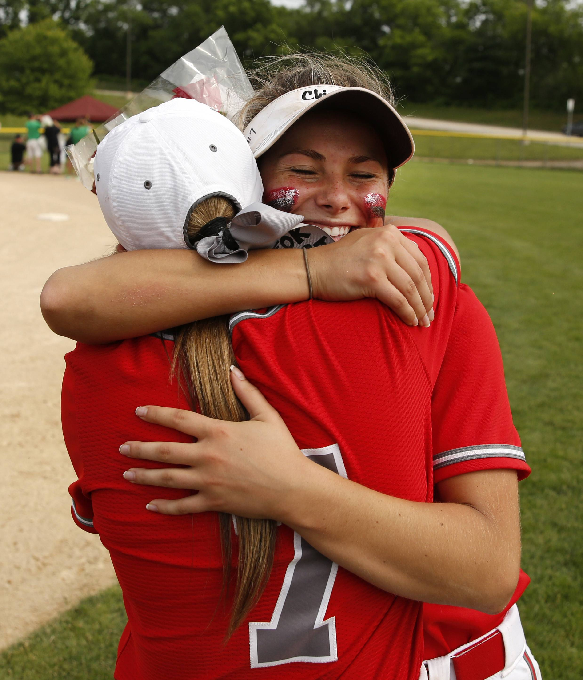 Palatine's Emily Parrott and Brittany Padden (7) celebrate their 2-0 win over York in the Class 4A third-place game.