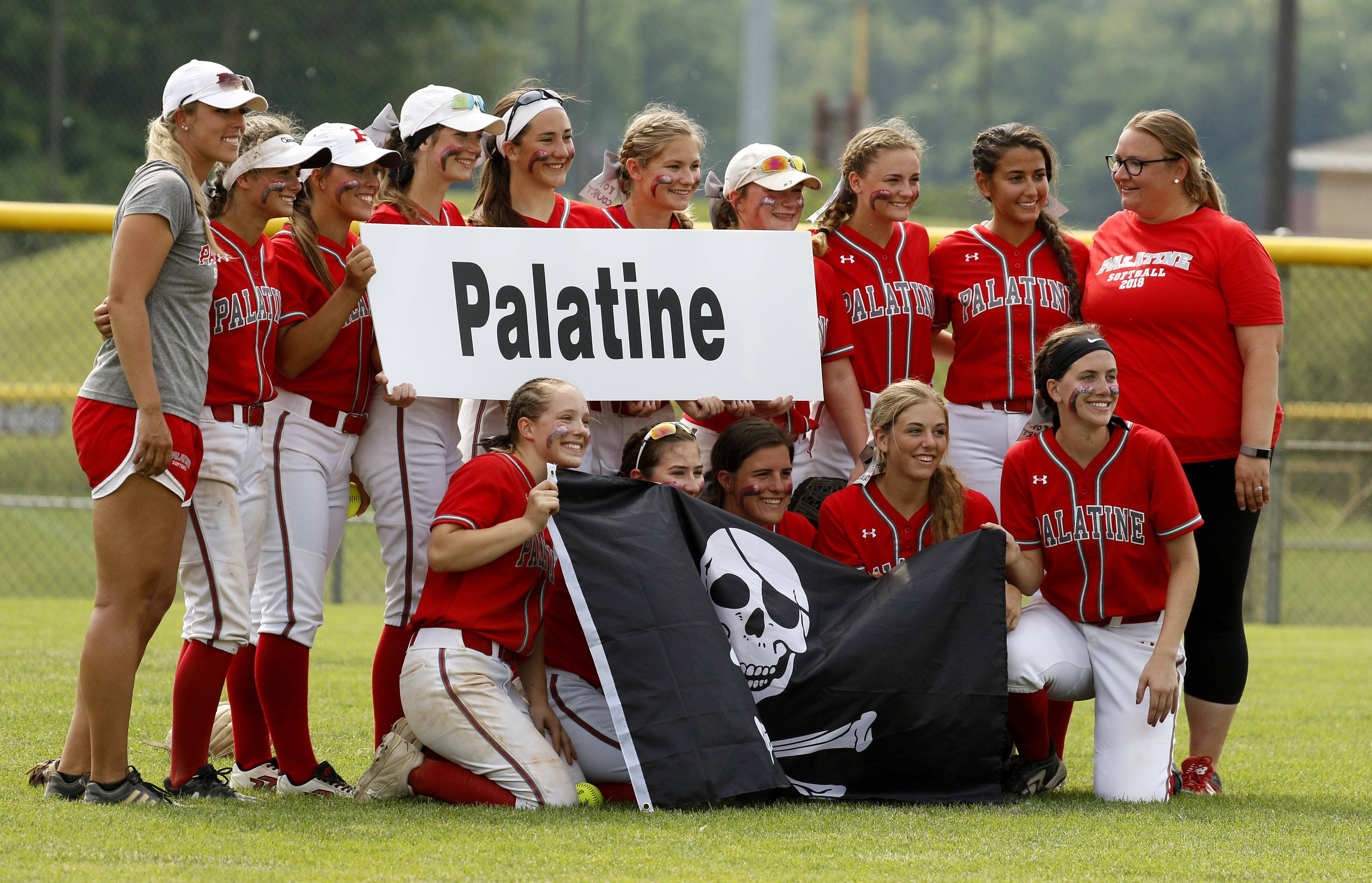 Palatine players and coaches pose for a photo after their 2-0 win over York, in the Class 4A third-place game.