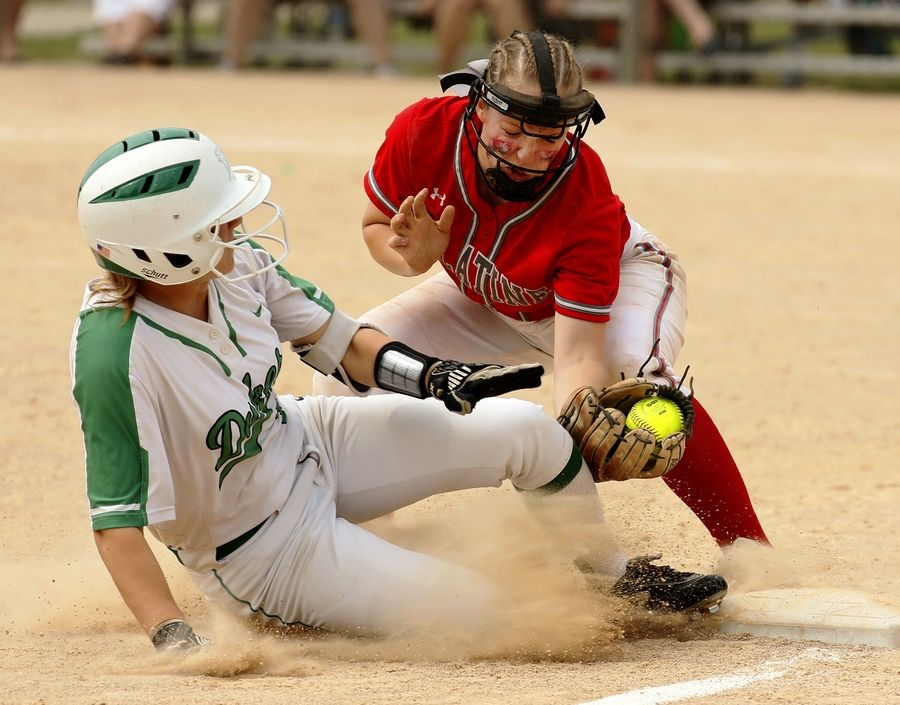Palatine third baseman Maddie Craver tags out York's Julia Dertkowski during the Class 4A third-place game.