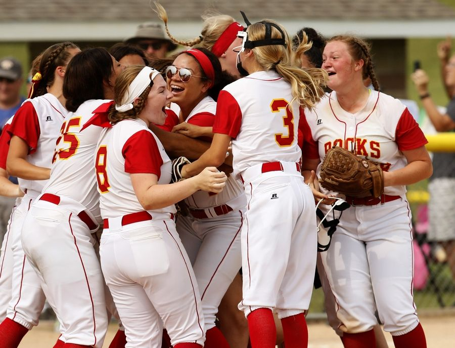 Rock Island players celebrate their 2-1 victory over Plainfield North to win the Class 4A softball state championship.