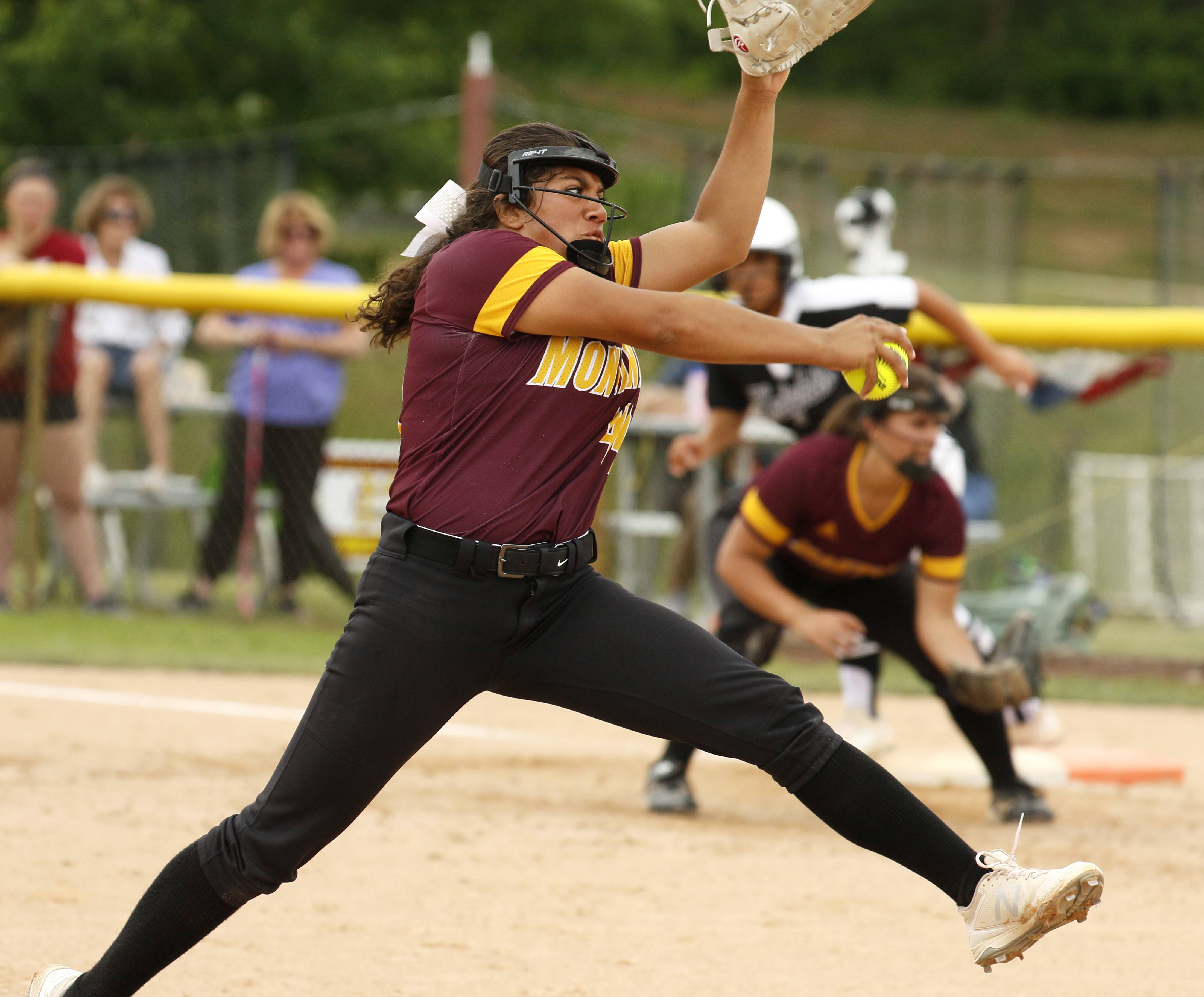 Montini Catholic pitcher Brianna Clifton throws to the plate against Kaneland.