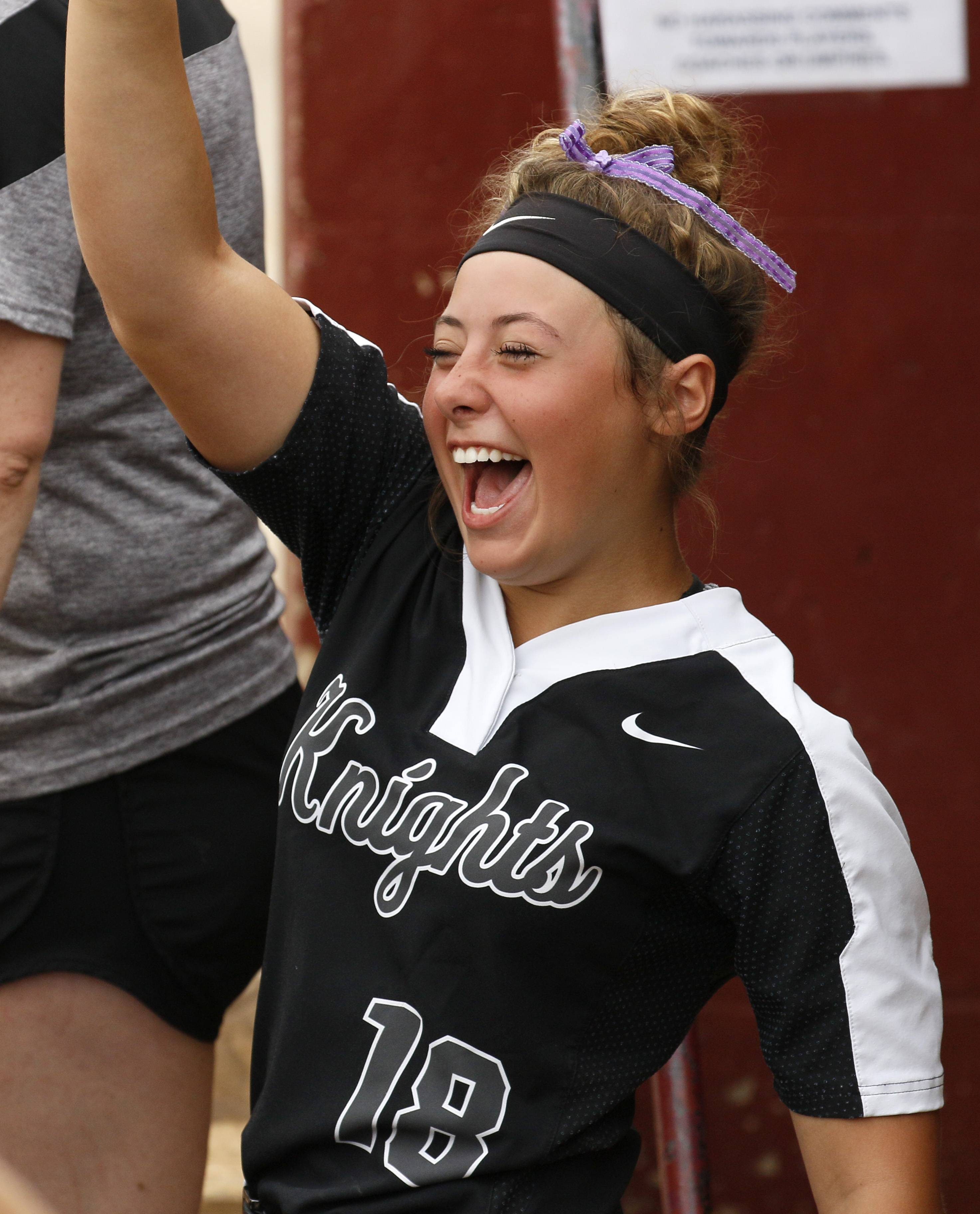 Kaneland's McKenna Ryan (18) celebrates her team's offense early in the game against Montini Catholic during the IHSA Class 3A state softball championship.