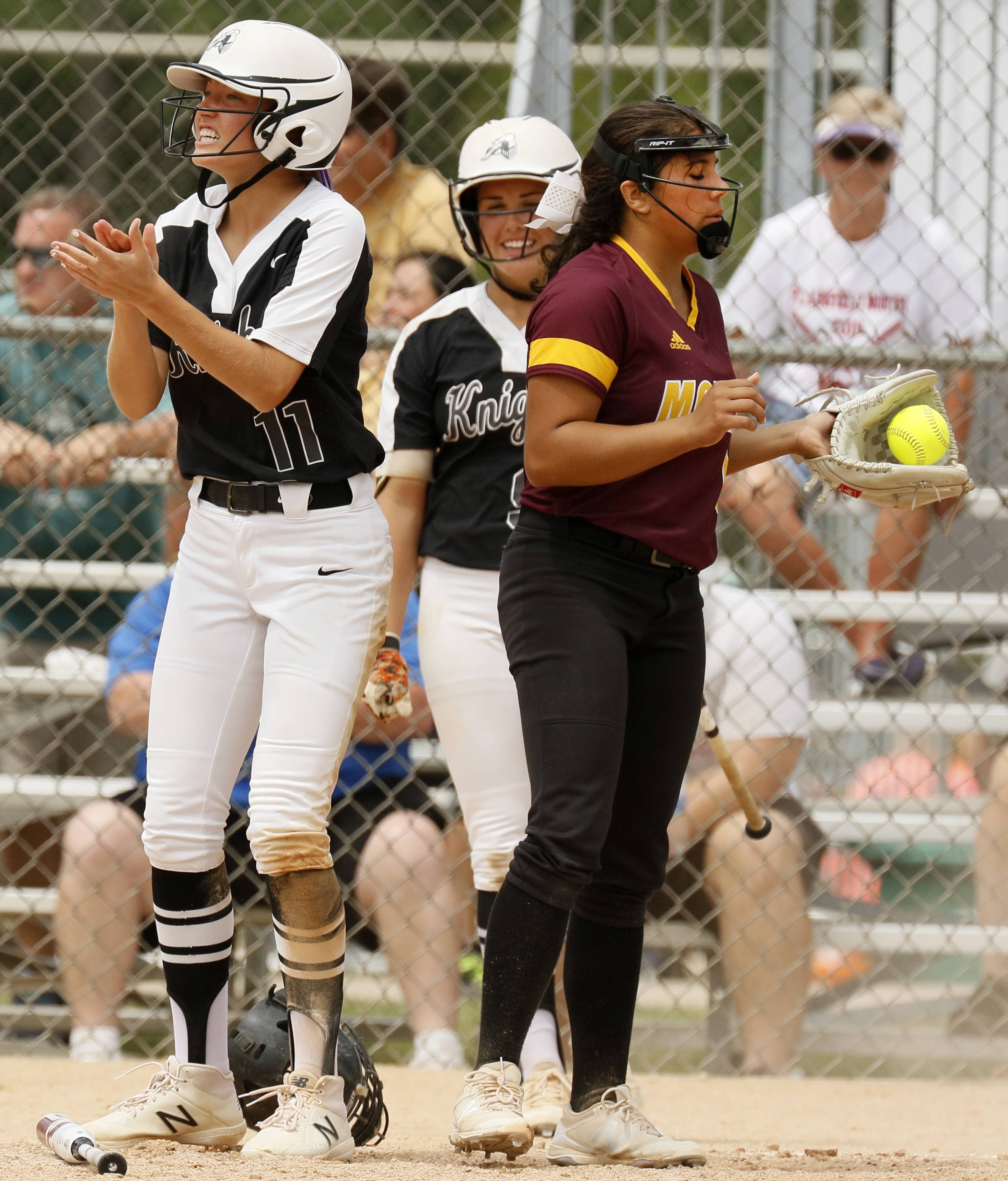 Kaneland's Olivia Ortegel (11) cheers after scoring due to an error by the Montini Catholic defense at the IHSA Class 3A state softball championship. Montini's Brianna Clifton, right, holds the ball.