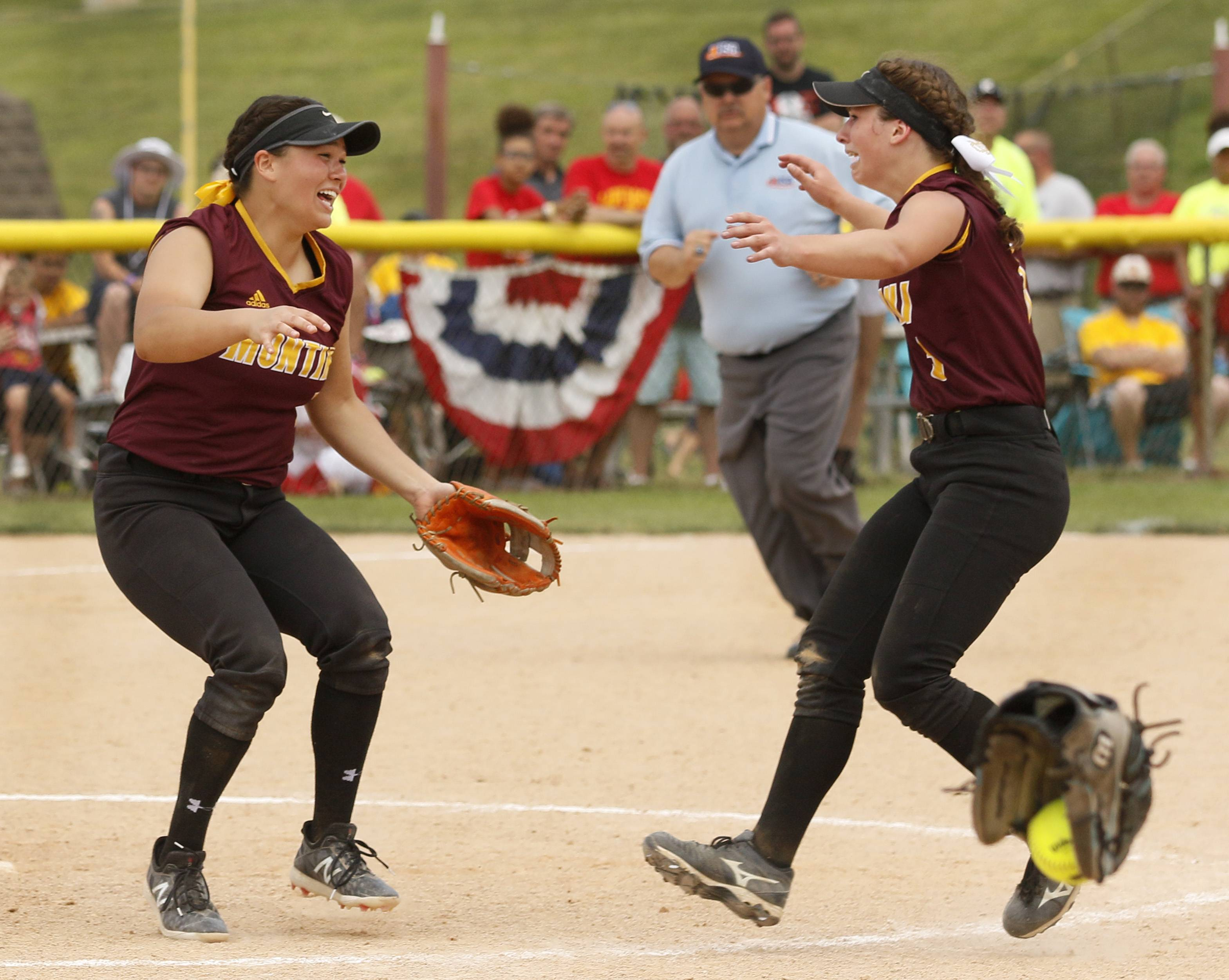 Montini Catholic's Nicole Cuchran, left, and Lauren Latoria, right celebrate their epic 15-8 victory against Kaneland to win the IHSA Class 3A state softball championship.