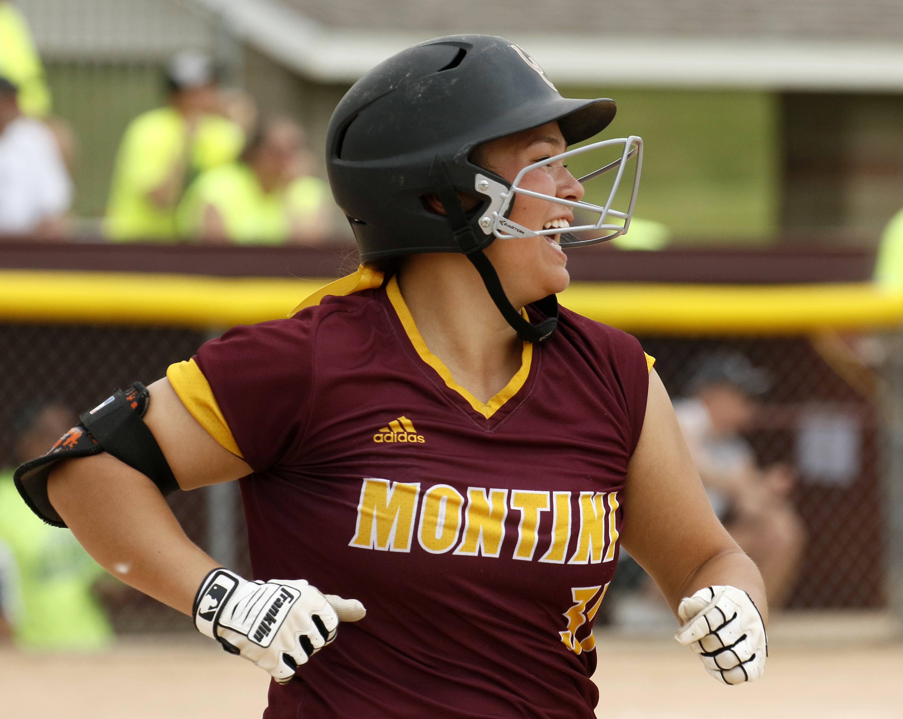 Montini Catholic's Nicole Cuchran (31) rounds first base after hitting a home run against Kaneland during the IHSA Class 3A state softball championship.