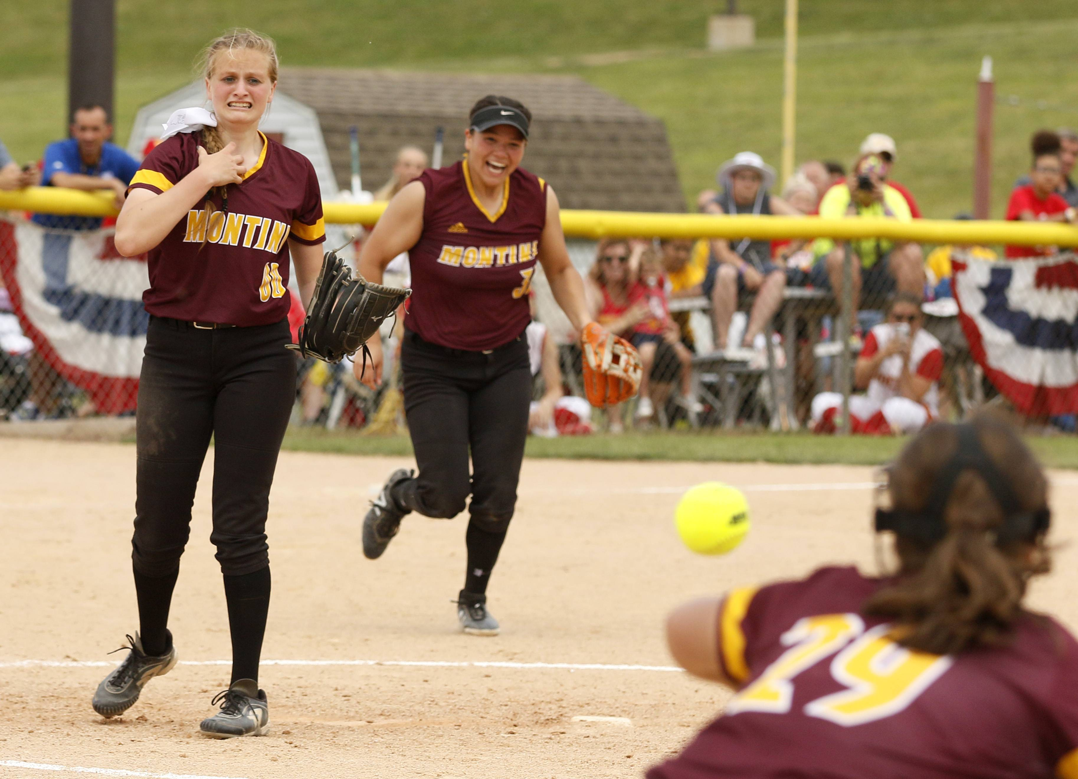 Montini Catholic's Allyson Dilday, left, watches the final out during the Bronco's comeback win against Kaneland.