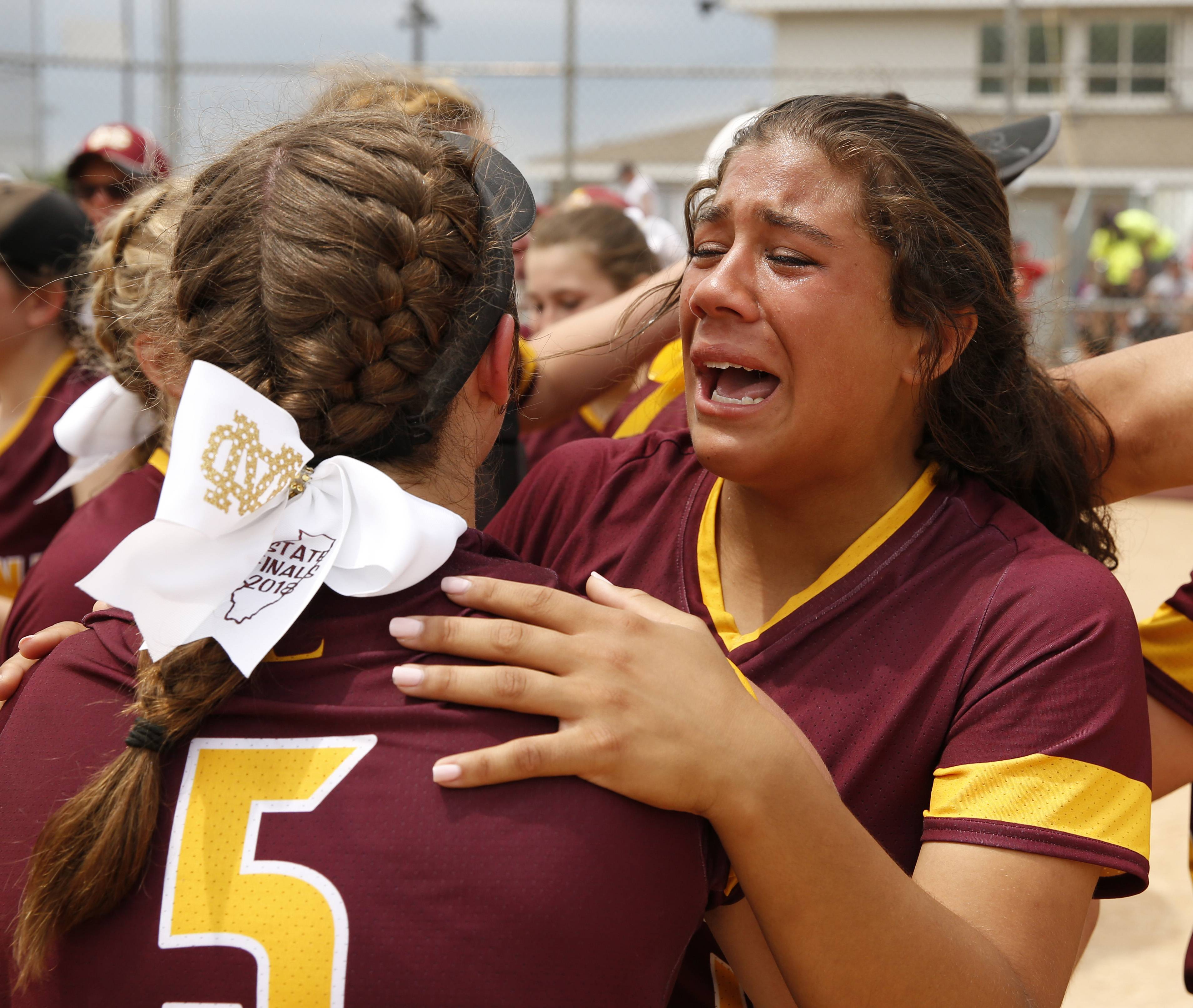Montini Catholic's Brianna Clifton, right, celebrates the Bronco's win against Kaneland.