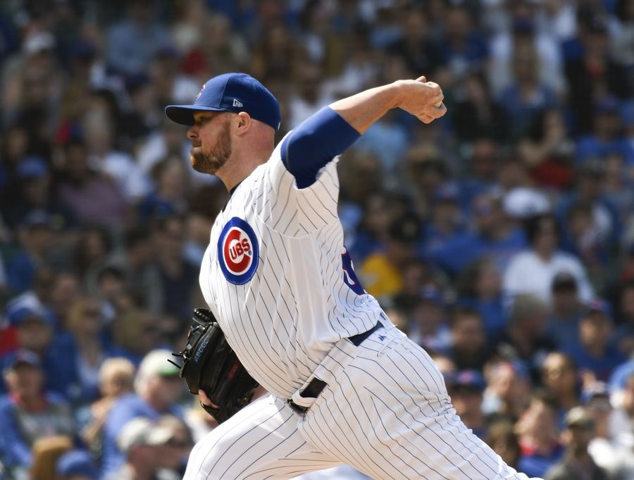 Cubs starting pitcher Jon Lester throws against the Pittsburgh Pirates during the sixth inning Saturday at Wrigley Field.