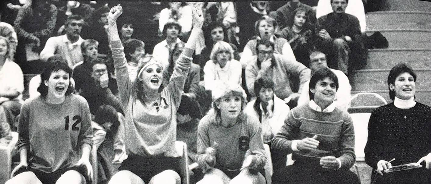 1986 Sectional Finals. From left, players Deena Reitman, Patty Kreuser and Heidi Coulson; head coach Linda Delano; and assistant coach/future head coach Chris Trzyna cheer a point in their winning effort.