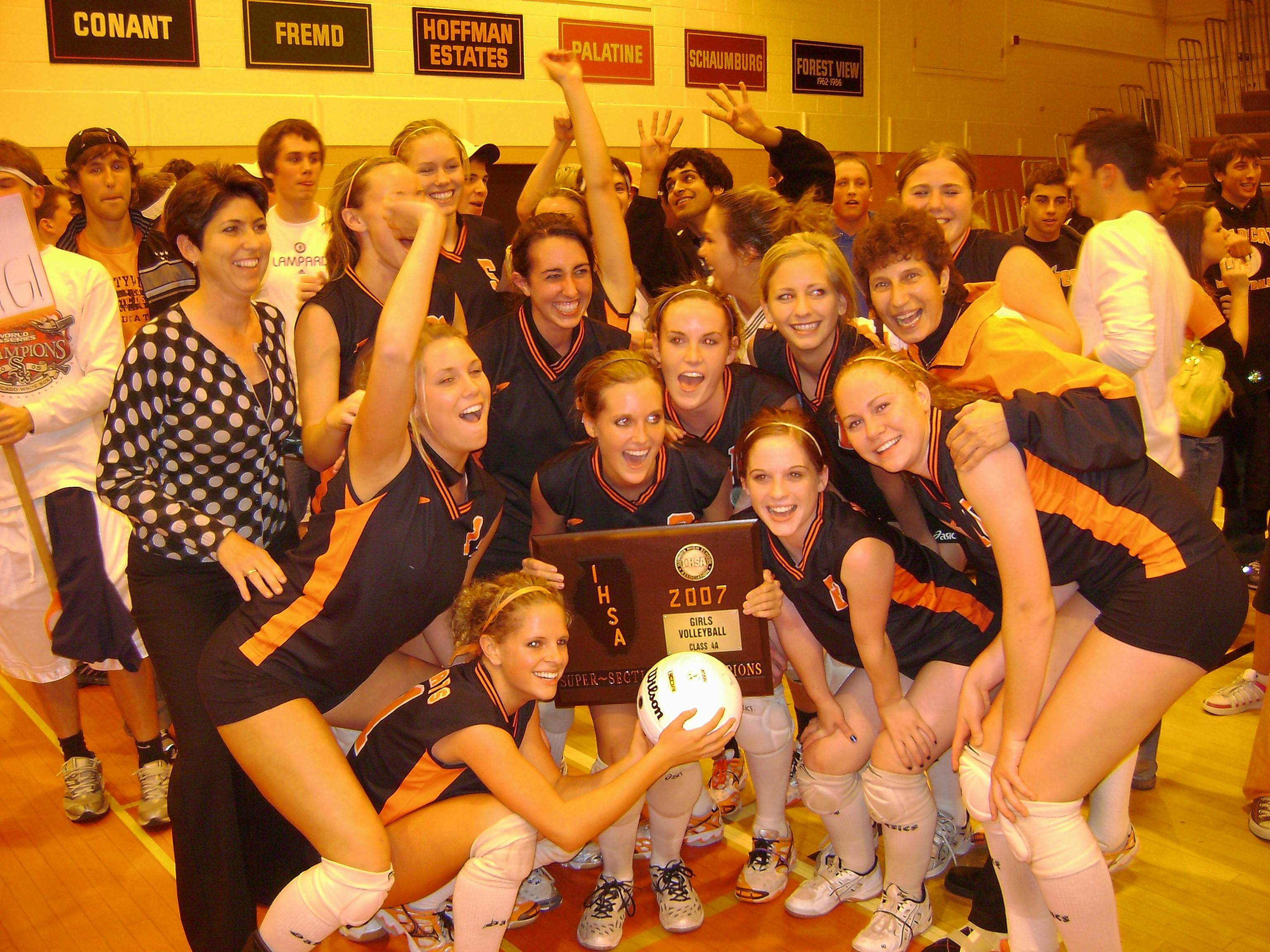 The 2007 Libertyville High School Volleyball team placed fourth in the state. Assistant coach Patti Mascia is on the left, head coach Chris Trzyna on the right, just behind All-Stater Ali Haws.