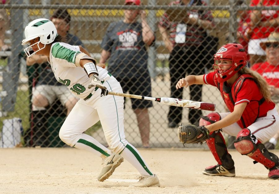 York's Izzy Smith motors to first base against Palatine during the Class 4A third-place game.