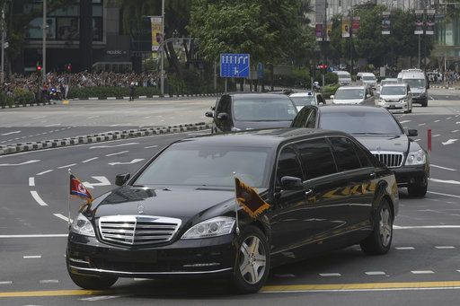 A limousine, front, with a North Korean flag believed to be carrying leader Kim Jong Un travels past Singapore's Orchard Road on its way to the St Regis Hotel as he arrives in Singapore on Sunday, June 10, 2018. Kim arrived Sunday in Singapore ahead of one of the most unusual summits in recent world history, a sit-down Tuesday with President Donald Trump.