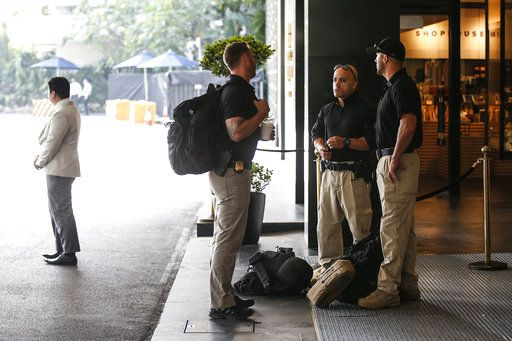 Members of the U.S. Secret Service Counter Sniper Team wait outside the lobby of the Shangri-La Hotel in Singapore, Sunday, June 10, 2018, ahead of the summit between U.S. President Donald Trump and North Korean leader Kim Jong Un.