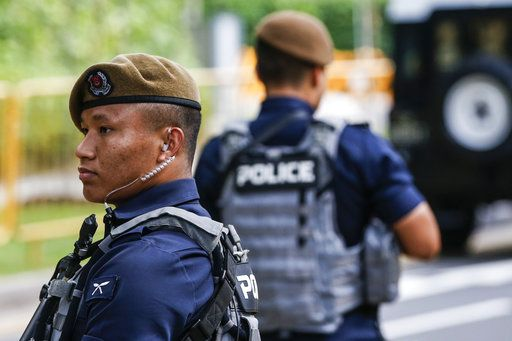 Gurkha police officers guard the perimeter of the Shangri-La Hotel in Singapore, Sunday, June 10, 2018, ahead of the summit between U.S. President Donald Trump and North Korean leader Kim Jong Un.