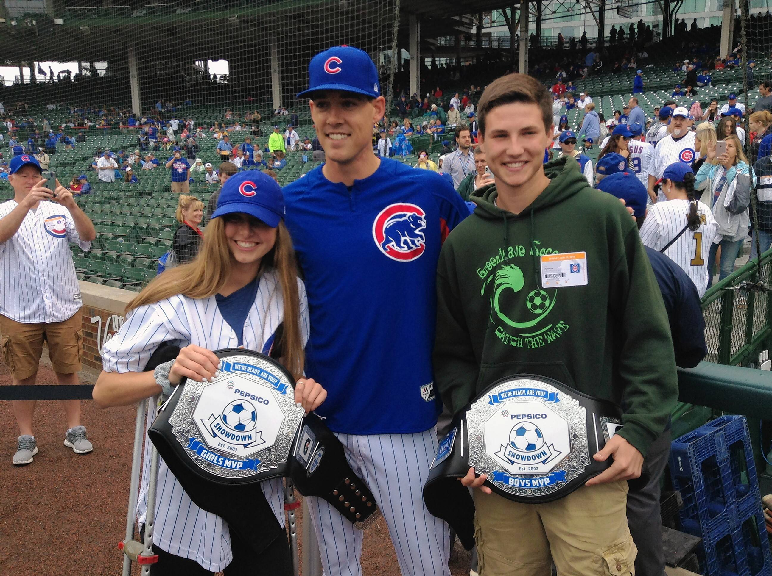 Wheaton Warrenville South's Paige Miller, left, and St. Edward's AJ Franklin were surprised by Cubs pitcher Luke Farrell with the 2017-18 PepsiCo Showdown MVP belts. Thanks to their outstanding play on the field, the two were identified as the top high school boys and girls soccer players in the 16th Annual PepsiCo Showdown, the largest high school soccer tournament in the U.S.