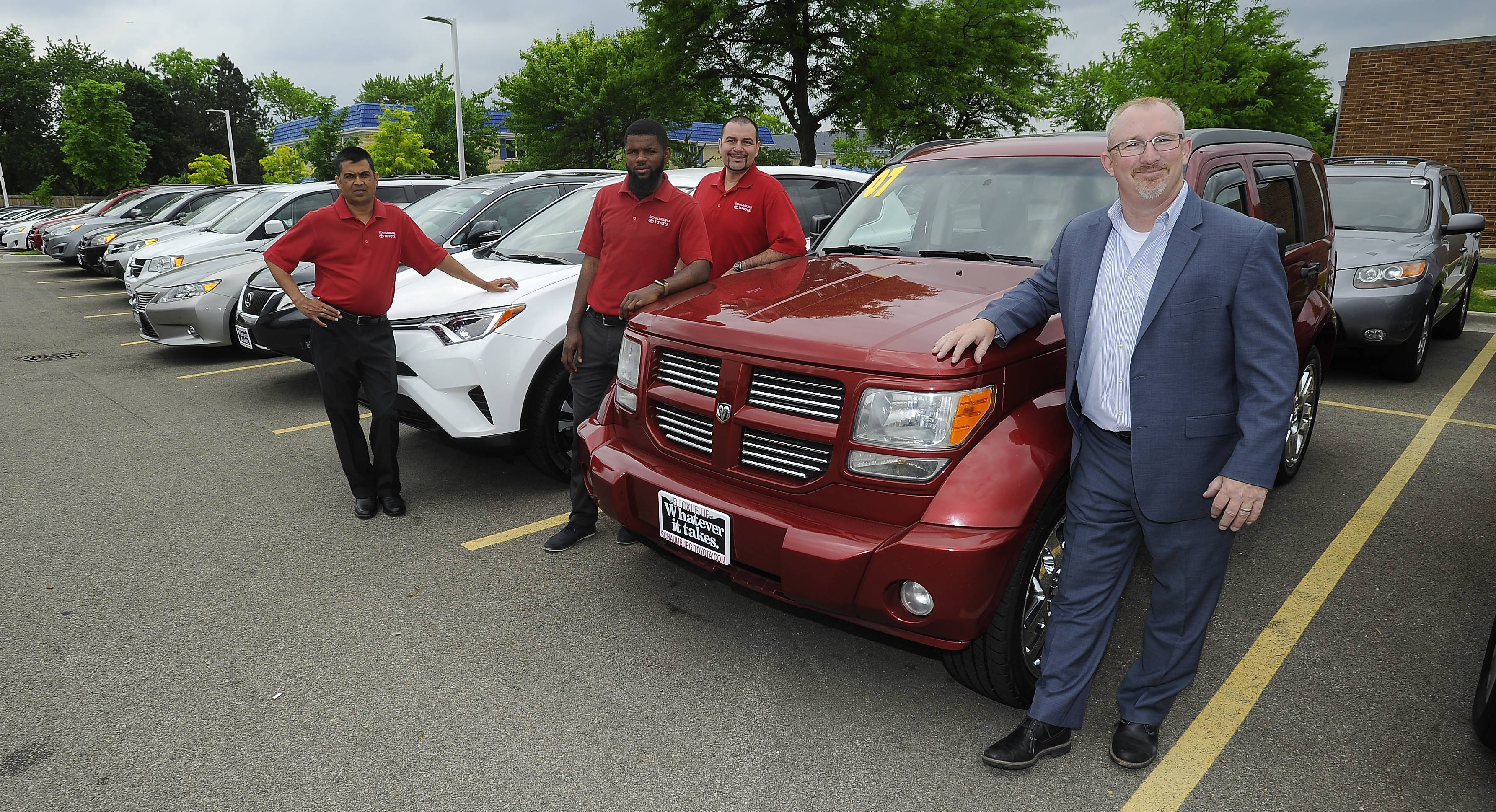 Chris Haley, general manager of Schaumburg Toyota, with Manoj Choradia, Idris Aroworade and Juan Vasquez, all sales professionals at the dealership. Sales and finance personnel will staff the tent sale through Saturday; all vehicles at the event will be sold.