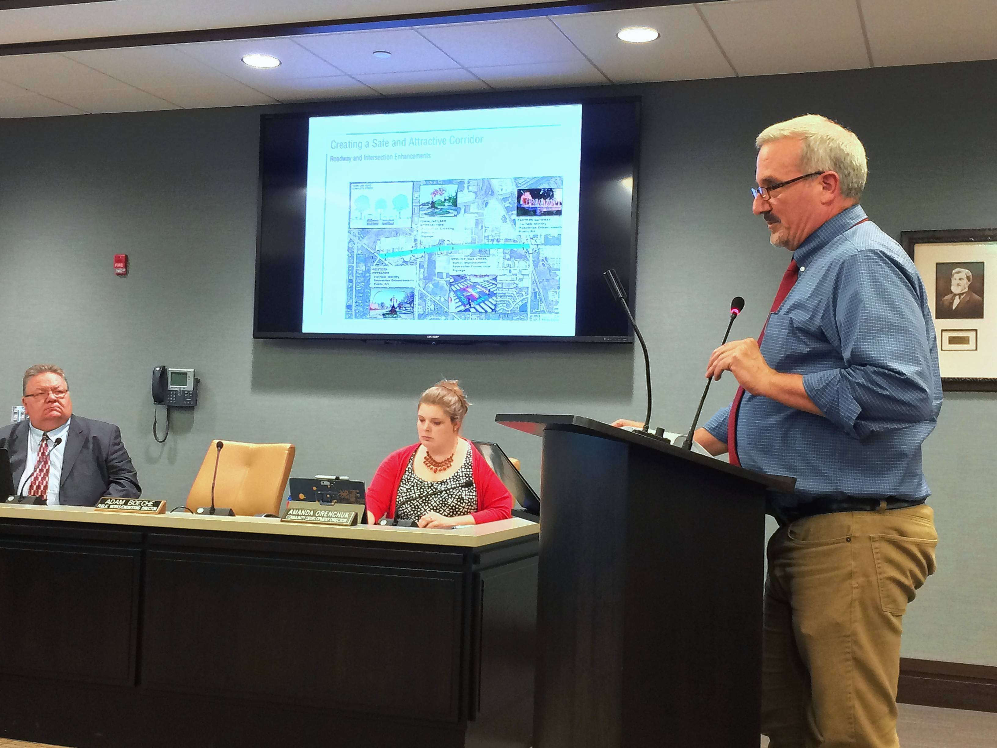 Urban Land Institute team member Joseph Maschek, right, tells Mundelein officials about things they can do to improve the village's south side commercial corridor during Monday's village board meeting.
