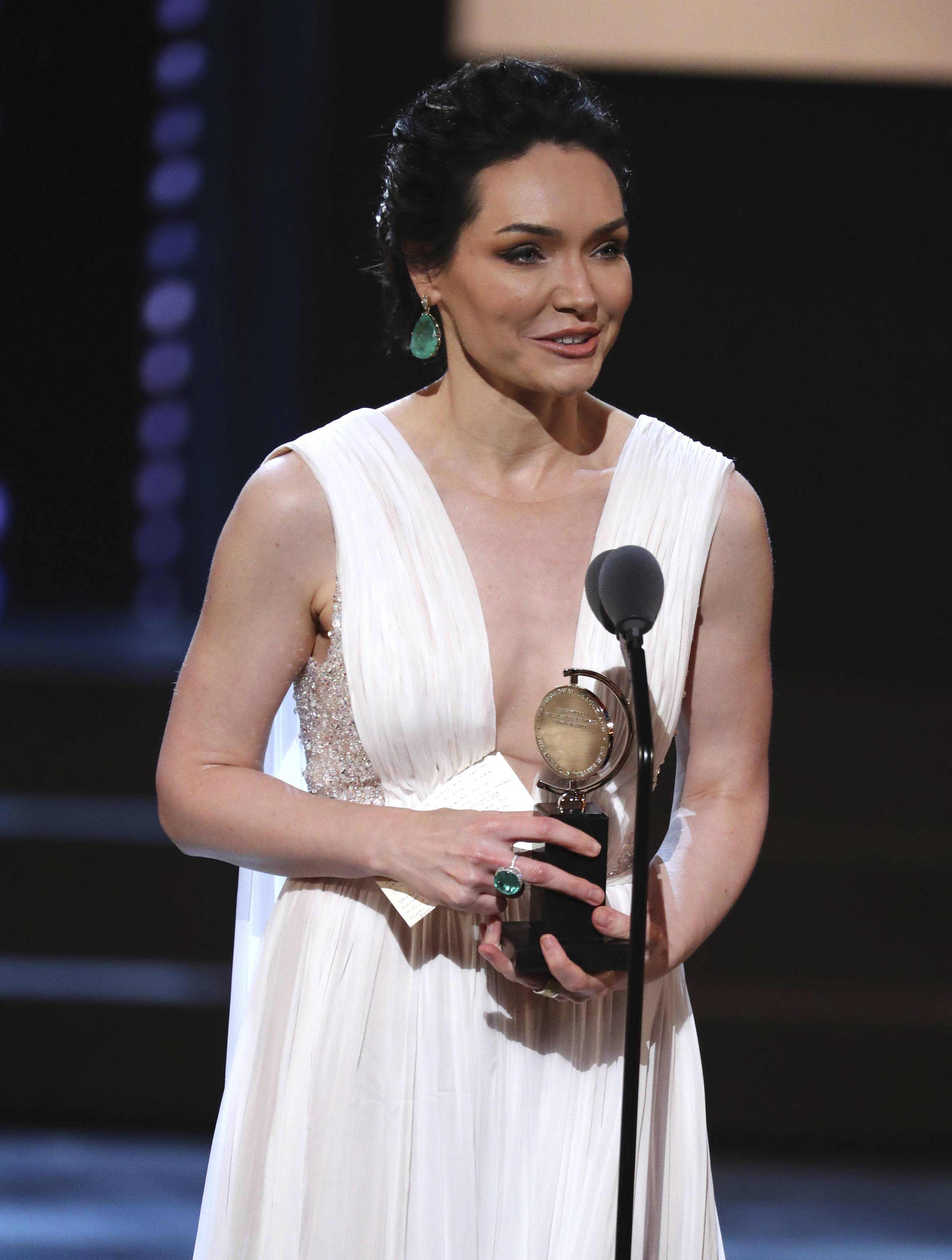 "Barrington High School alum Katrina Lenk accepts the Tony Award for leading actress in a musical for ""The Band's Visit"" at Sunday night's 72nd annual Tony Awards in New York."