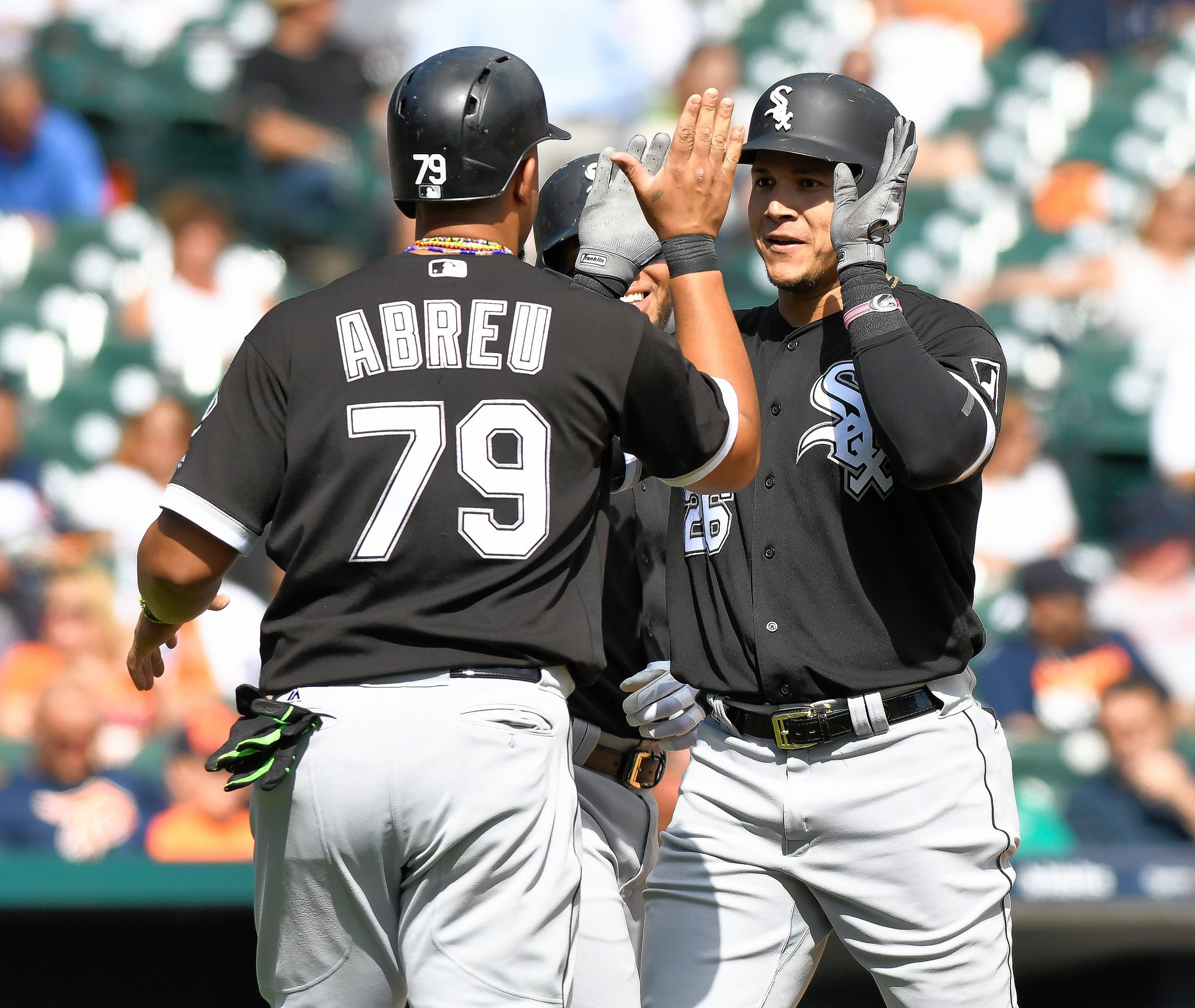 Chicago White Sox right fielder Avisail Garcia (26) is congratulated by first baseman Jose Abreu (79) after hitting a three-run home run against the Detroit Tigers during the sixth inning of a baseball game, Thursday, Sept. 14, 2017, in Detroit. The White Sox defeated the Tigers 17-7.
