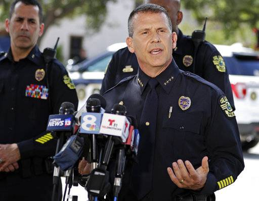 Orlando Police Chief John Mina answers questions at an afternoon news conference during a hostage standoff Monday, June 11, 2018, in Orlando, Fla. Police said a man suspected of battering his girlfriend shot a police officer late Sunday and barricaded himself inside an apartment with several young children.