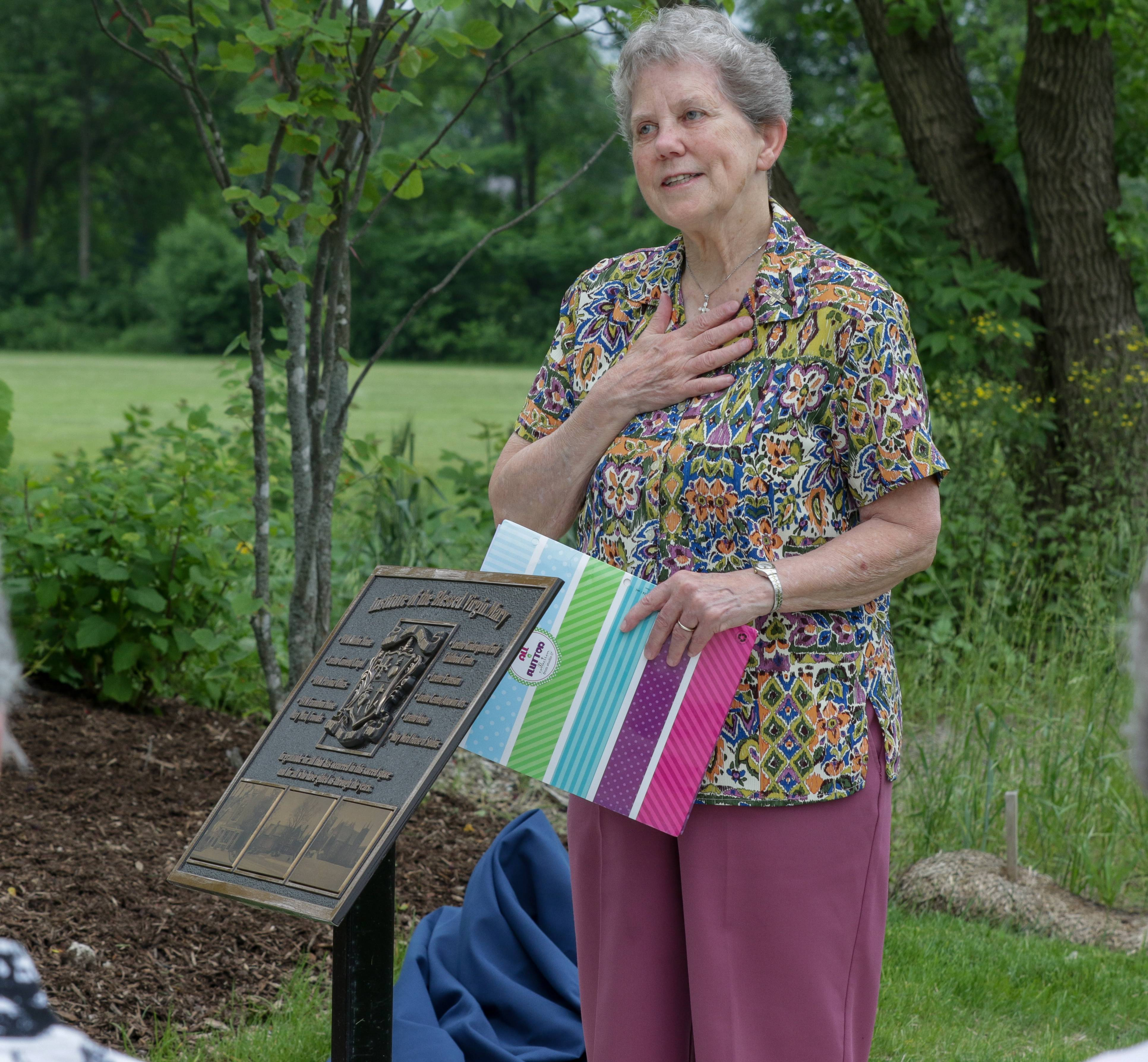 Sister Judy Illig helps unveil a plaque Tuesday as a tribute to the work of the Loretto nuns at their former convent in Wheaton.