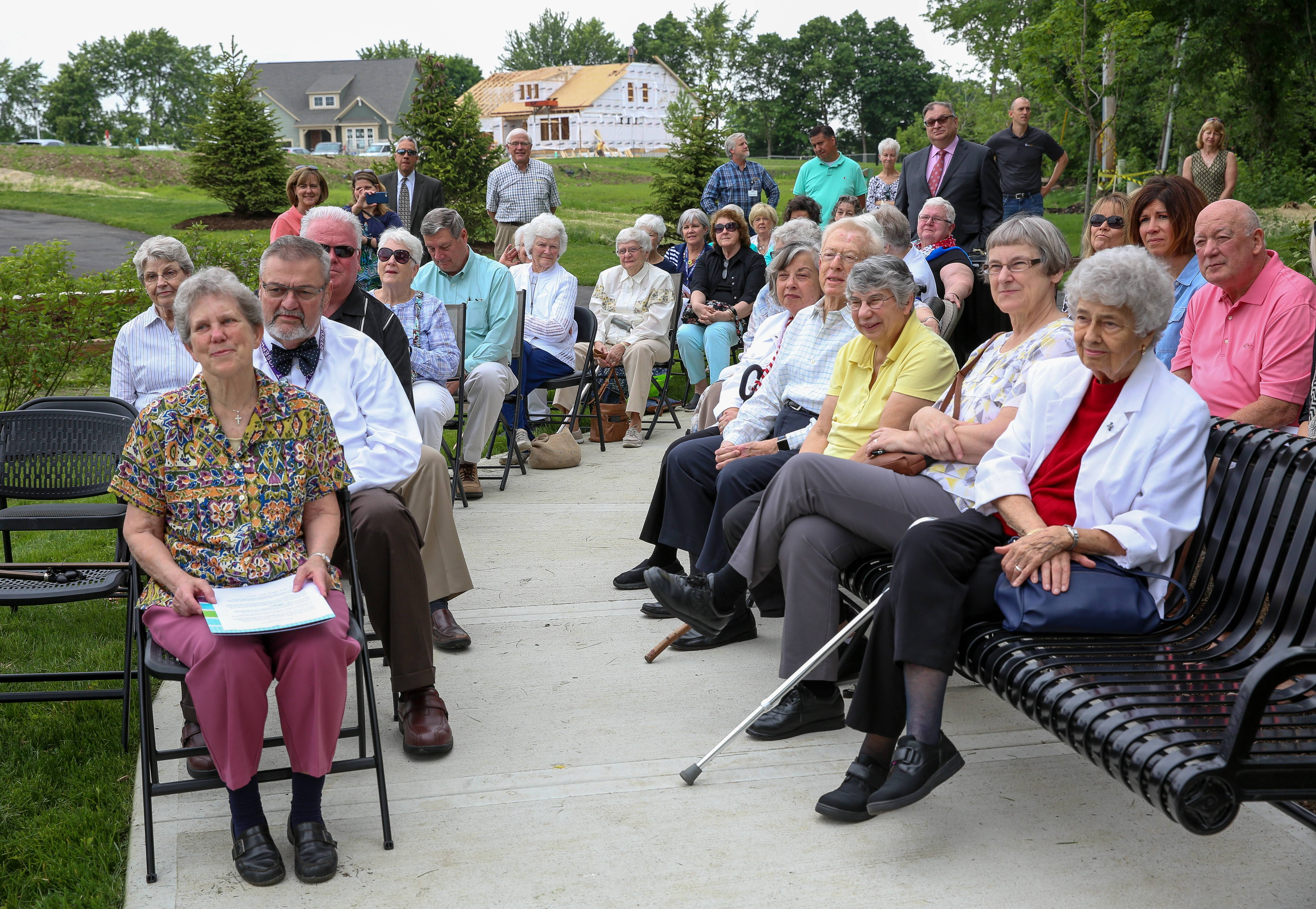 The plaque dedication drew a gathering of Loretto nuns, Pulte developers, Wheaton Mayor Michael Gresk and other supporters of the religious community.