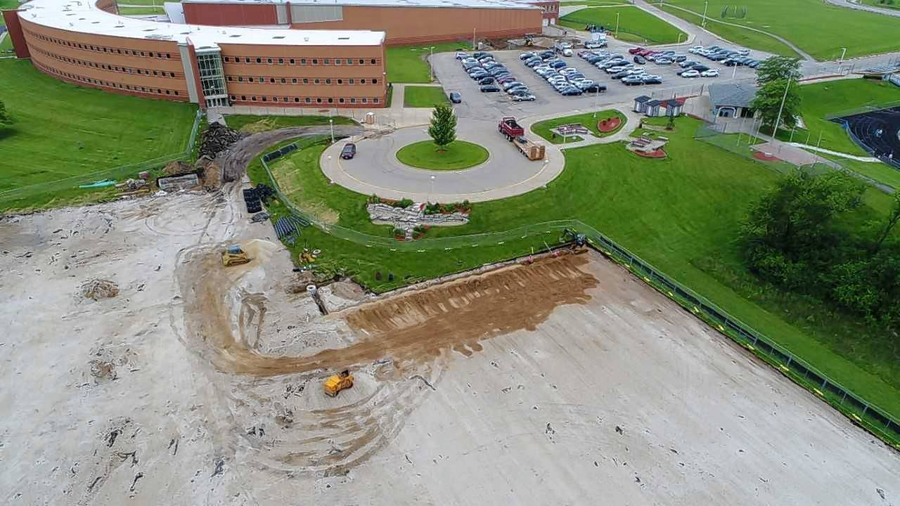 Crystal Lake Central's parking lot resurfacing is part of nearly $14 million in improvements being made this summer at Crystal Lake High School District 155's four high schools.