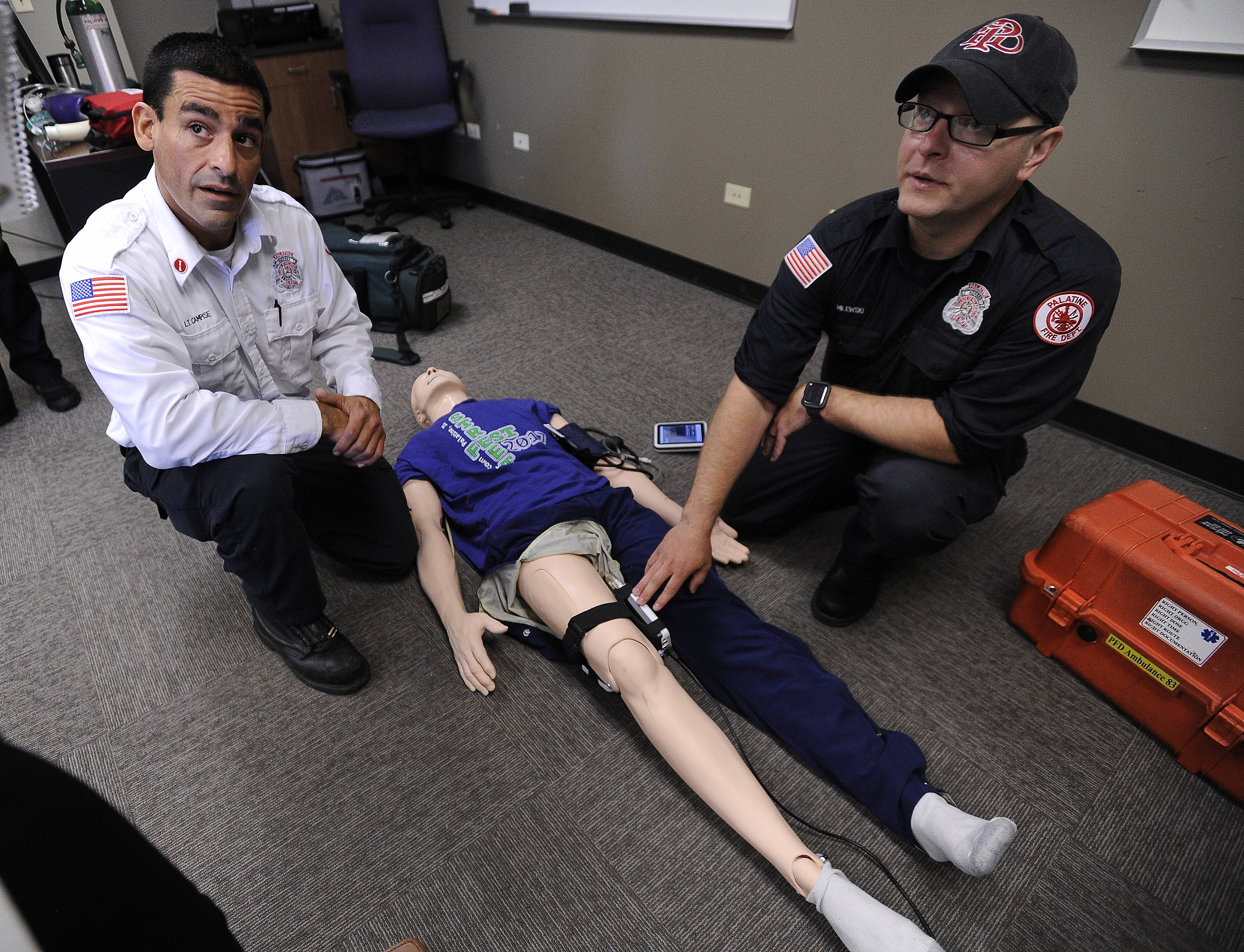 Palatine Fire Department Lt. Marc Campise and Firefighter/Paramedic Andrew Milewski show off the department's new, high-tech training manikin on Tuesday. The manikin can be adjusted to present trainees with a variety of situations.