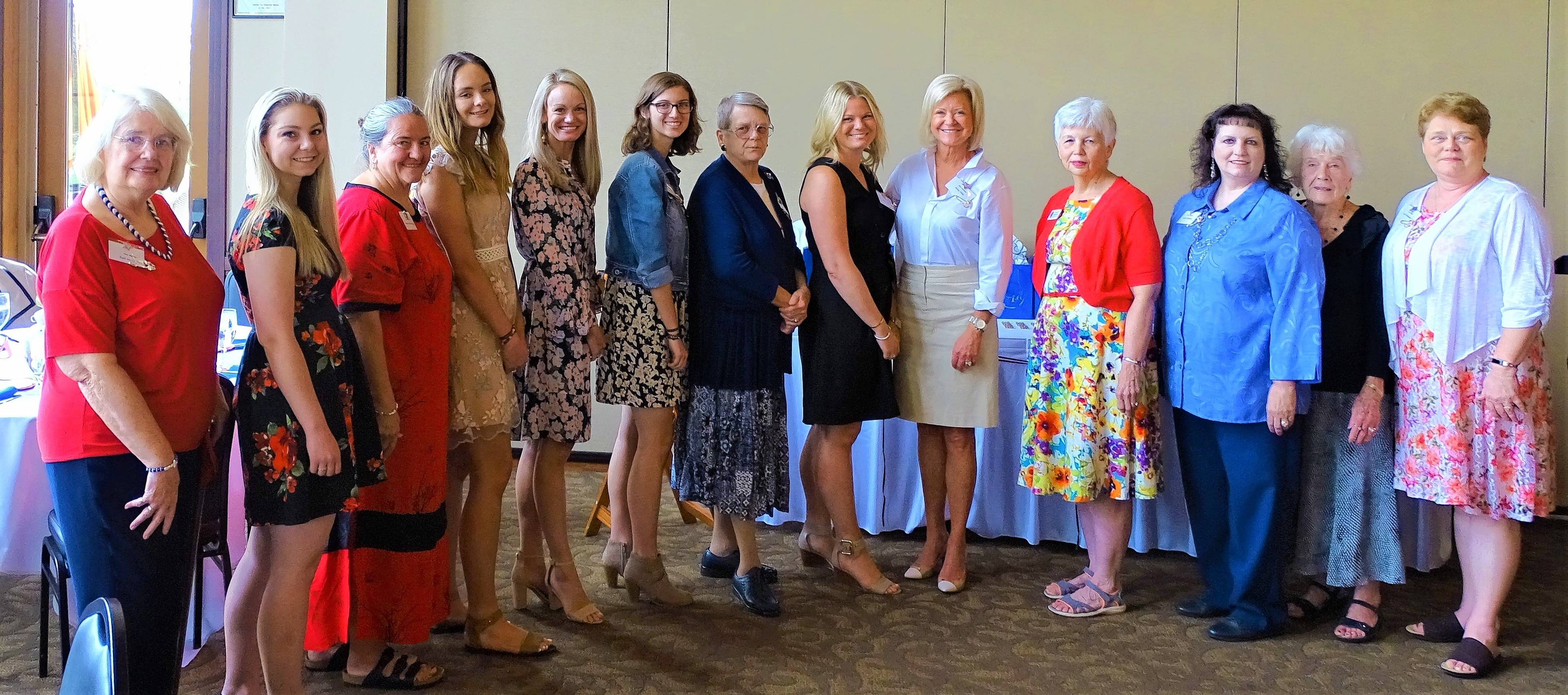 New members are welcomed at the Fox River Valley DAR's annual meeting. Pictured, from left, are Gail McCusker, Brooke Wold, Virginia Werthwein, Hanna Vojtech, Virginia Pondel, Emily McCusker, Mary Lischalk, Amy and Mary Holz, Marilyn Foley, Lynne DiSimoni, Joyce Dennison and Lola Blakeman.