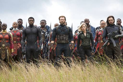 "This image released by Marvel Studios shows, front row from left, Danai Gurira, Chadwick Boseman, Chris Evans, Scarlet Johansson and Sebastian Stan in a scene from ""Avengers: Infinity War."" The supersized superhero hit has crossed $2 billion in worldwide ticket sales, becoming only the fourth film to reach that rarified box-office milestone. (Chuck Zlotnick/Marvel Studios via AP)"