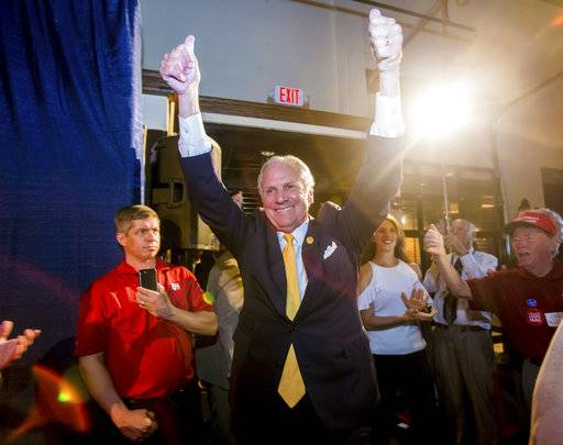South Carolina Gov. Henry McMaster enters his election night party at Vista Union Tuesday, June 12, 2018 in Columbia, S.C. McMaster was forced into a runoff for the Republican gubernatorial nomination. He  was the top vote-getter in primary voting but failed to win the 50 percent necessary to avoid a runoff. He and Greenville businessman John Warren will face off in a second contest on June 26. (Jeff Blake/The State via AP)