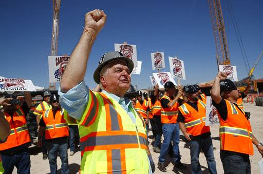 Clark County Commission member and Democratic gubernatorial candidate Steve Sisolak chants with supporters while touring the site of the future Raiders football stadium Monday, June 11, 2018, in Las Vegas.
