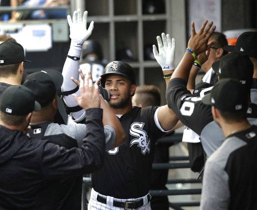 Chicago White Sox's Yoan Moncada celebrates his home run off Cleveland Indians starting pitcher Adam Plutko during the first inning of a baseball game Tuesday, June 12, 2018, in Chicago.