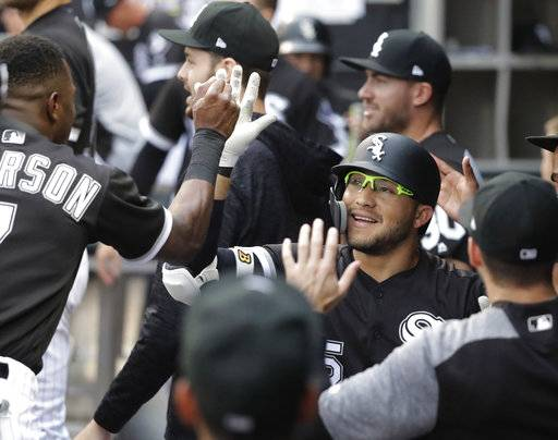 Chicago White Sox's Yolmer Sanchez is congratulated for his home run off Cleveland Indians starting pitcher Adam Plutko during the first inning of a baseball game Tuesday, June 12, 2018, in Chicago.