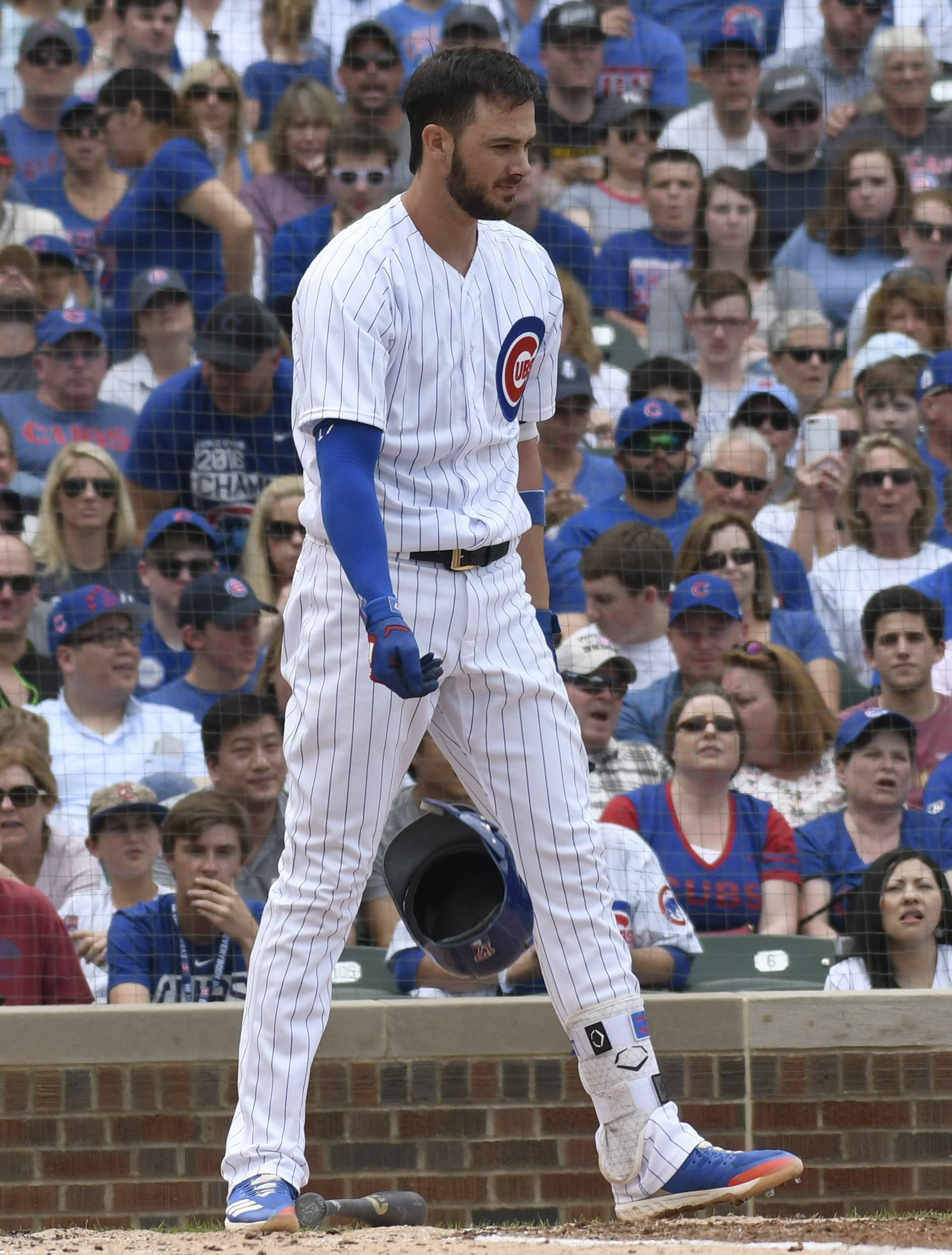 Chicago Cubs' Kris Bryant reacts after striking out against the Pittsburgh Pirates during the second inning of a baseball game Saturday, June 9, 2018, in Chicago.