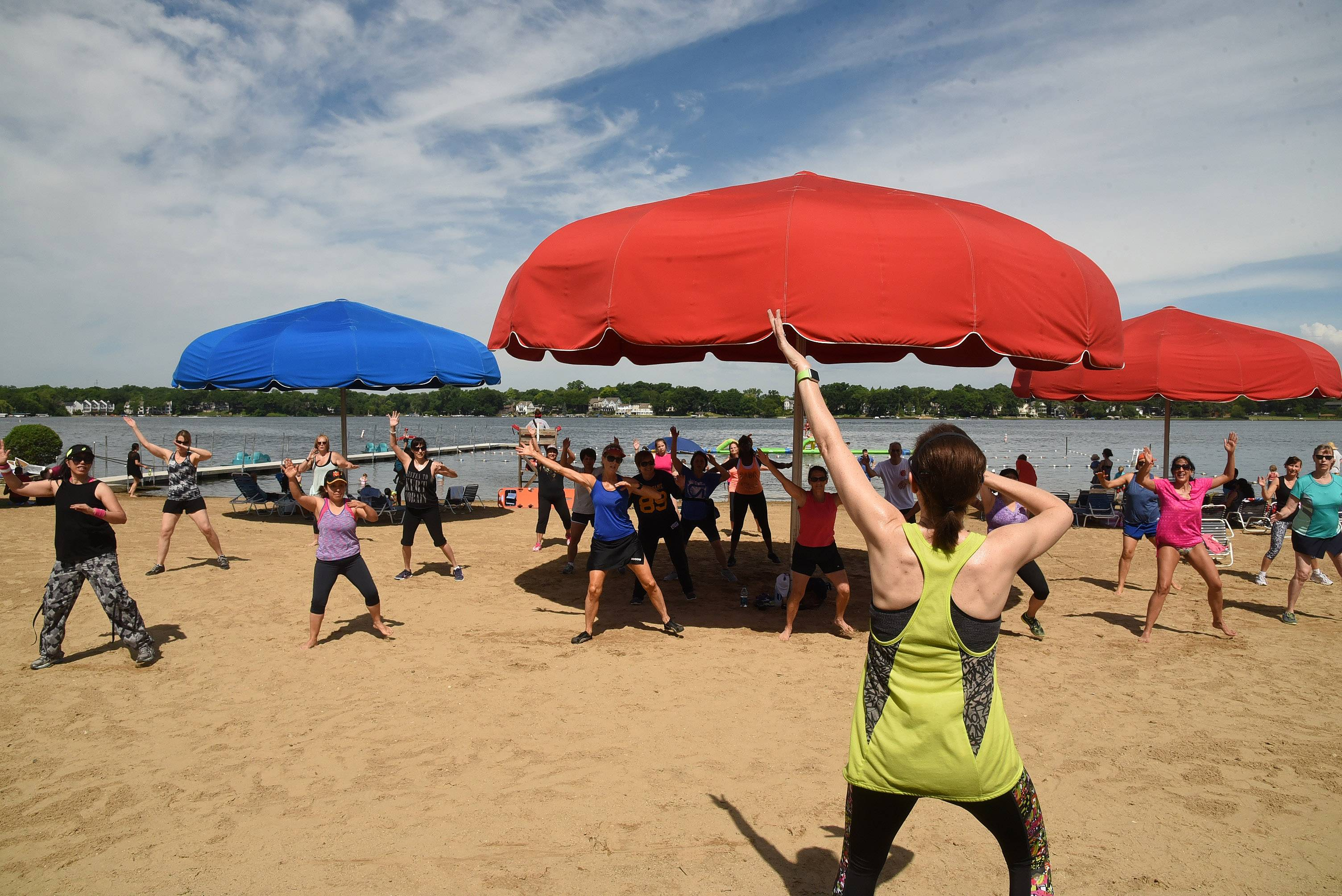A Zumba instructor leads a class on the beach during Mundelein Park & Recreation District's Community Picnic at Diamond Lake Beach. The event, renamed the Beach Bash, will be held from 10 a.m. to 8 p.m. Saturday, June, 16 at Diamond Lake Beach.