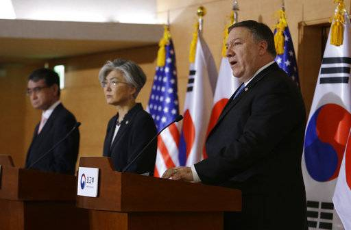 U.S. Secretary of State Mike Pompeo, right, speaks as South Korean Foreign Minister Kang Kyung-wha, center, and Japanese Foreign Minister Taro Kono listen during a joint press conference following their meeting at Foreign Ministry in Seoul, South Korea, Thursday, June 14, 2018.
