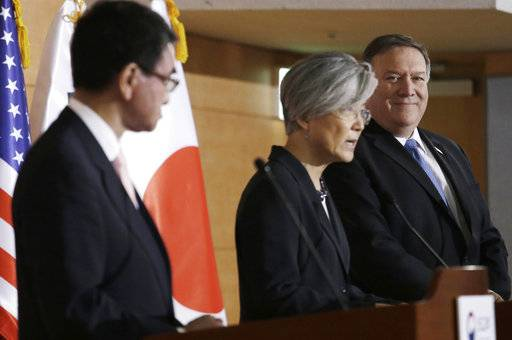 U.S. Secretary of State Mike Pompeo, right, and Japanese Foreign Minister Taro Kono, left, listen to South Korean Foreign Minister Kang Kyung-wha during a joint press conference following their meeting at Foreign Ministry in Seoul, South Korea, Thursday, June 14, 2018.