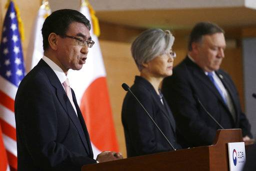 Japanese Foreign Minister Taro Kono, left, speaks as U.S. Secretary of State Mike Pompeo, right, and South Korean Foreign Minister Kang Kyung-wha listen during a joint press conference following their meeting at Foreign Ministry in Seoul, South Korea, Thursday, June 14, 2018.