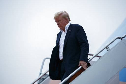 U.S. President Donald Trump arrives at Andrews Air Force Base after a summit with North Korean leader Kim Jong Un in Singapore, Wednesday, June 13, 2018, in Andrews Air Force Base, Me.