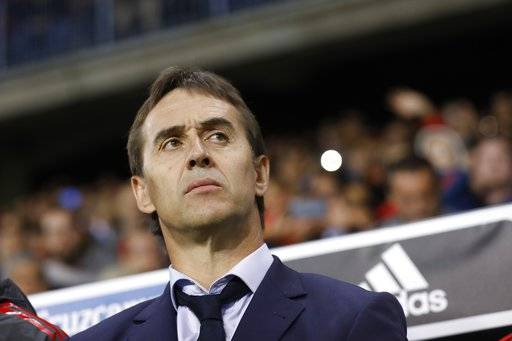 FILE - In this Saturday, Nov. 11, 2017 filer, Spain coach Julen Lopetegui stands by the bench during the international friendly soccer match between Spain and Costa Rica in Malaga, Spain.