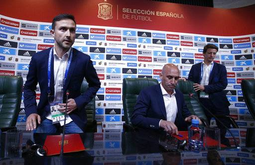Spanish football president Luis Rubiales, center, attends a press conference at the 2018 soccer World Cup in Krasnodar, Russia, Wednesday, June 13, 2018. The Spanish soccer federation has fired coach Julen Lopetegui two days before the country's opening World Cup match against Portugal. Lopetegui was let go a day after Real Madrid announced him as its new coach following the World Cup.