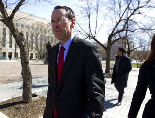FILE- In this March 22, 2018, file photo, AT&T CEO Randall Stephenson leaves the federal courthouse in Washington. The judge presiding over the government's legal effort to block AT&T's purchase of Time Warner will likely deliver his verdict on Tuesday, June 12.