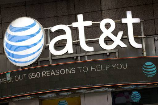 FILE - In this Monday, Oct. 24, 2016, file photo, the AT&T logo is positioned above one of its retail stores, in New York.  The fate of the AT&T-Time Warner merger, a massive media deal opposed by the government that could shape how much consumers pay for streaming TV and movies, rests in the hands of a federal judge.  U.S. District Judge Richard Leon is expected to announce in court Tuesday, June 12, 2018  his decision in the biggest antitrust trial in years.