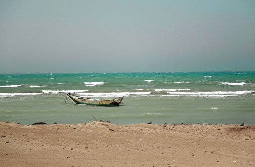 FILE - In this Feb. 12, 2018 file photo, a small boat is anchored near the Red Sea port of Hodeida, Yemen. The Saudi-led coalition backing Yemen's exiled government began an assault Wednesday, June 13, 2018 on the port city of Hodeida, the main entry point for food in a country already teetering on the brink of famine.