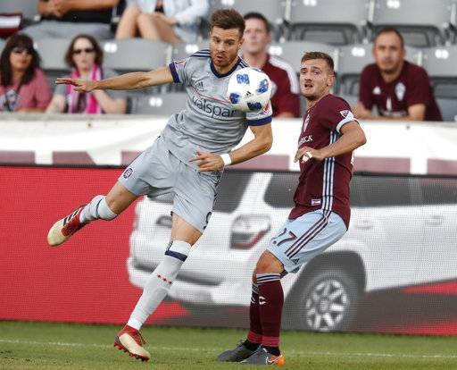 Chicago Fire forward Luis Solignac, left, pursues the ball with Colorado Rapids defender Deklan Wynne during the first half of an MLS soccer match Wednesday, June 13, 2018, in Commerce City, Colo.