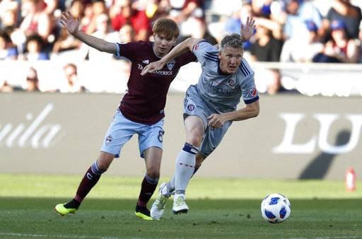 Chicago Fire midfielder Bastian Schweinsteiger, front, drives past Colorado Rapids midfielder Johan Blomberg during the first half of an MLS soccer match Wednesday, June 13, 2018, in Commerce City, Colo.