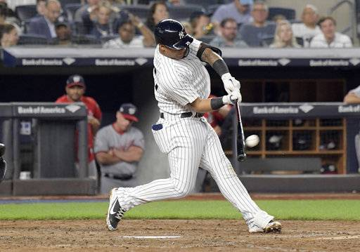 New York Yankees' Gleyber Torres hits a home run during the fifth inning of a baseball game against the Washington Nationals on Wednesday, June 13, 2018, at Yankee Stadium in New York.