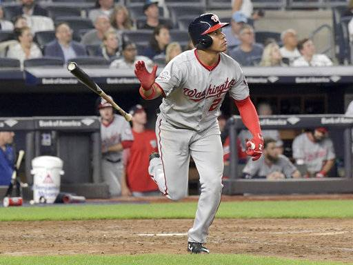 Washington Nationals' Juan Soto tosses his bat after hitting a home run against the New York Yankees during the seventh inning of a baseball game Wednesday, June 13, 2018, at Yankee Stadium in New York.