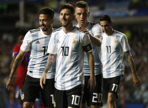 FILE - In this May 29, 2018 file photo Argentina's Manuel Lanzini, left, Giovanni Lo Celso, second right, and Angel Di Maria, right, congratulate teammate Lionel Messi, second left, after his hat trick during a friendly soccer match between Argentina and Haiti at the Bombonera stadium in Buenos Aires, Argentina. In theory, two-time World Cup winner Argentina really shouldn't be fearful of facing Iceland, which is making its first appearance at the tournament. But there is a bit of worry in the Argentina camp: the height effect because Argentina is among the shortest teams at the tournament at 1.79 meters
